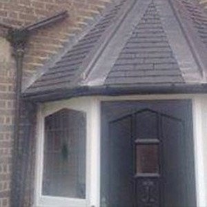 Slate tiling above door