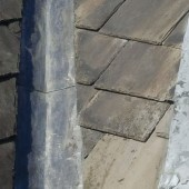 Completed lead flashing work alongside new tiles